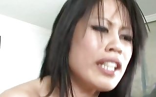 Busty brunette Asian bitch sprayed all over her big jugs